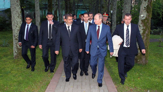 April 19, 2013. Russian President Vladimir Putin, second right, before the news conference on the results of his meeting with the President of Egypt Mohamed Morsi, third left, in Sochi.(RIA Novosti / Mikhail Klimentyev)