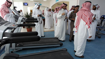 The spokesman for the Saudi minister of interior General Mansour Turki (2R) is given a tour alongside other media representatives of a new centre for the rehabilitation of suspected