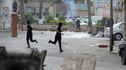 Protesters run for cover from the tear-gas fired by riot-police during clashes in the village of Jidhafs, west of Manama, April 20, 2013.(Reuters / Stringer)
