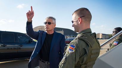 US Secretary of Defense Chuck Hagel gestures before boarding an aircraft at Joint Base Andrews, MD, on April 20, 2013.(AFP Photo / Jim Watson)
