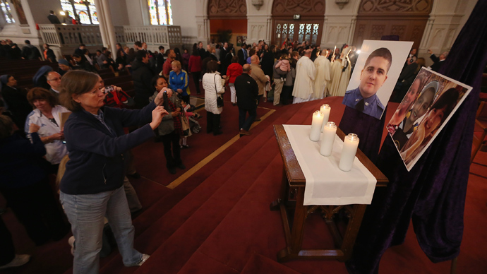 Photos of the deceased are displayed following Mass at the Cathedral of the Holy Cross on the first Sunday after the Boston Marathon bombings on April 21, 2013 in Boston, Massachusetts (AFP Photo / Mario Tama)