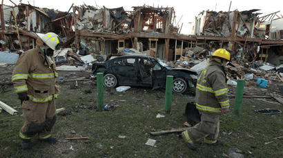 Valley Mills Fire Department personnel walk among the remains of an apartment complex next to the fertilizer plant that exploded yesterday afternoon on April 18, 2013 in West, Texas. (AFP Photo / Erich Schlegel)
