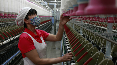 This picture taken on April 10, 2013 shows a laborer working in a textile factory in Huaibei, central China's Anhui province.  (AFP Photo)