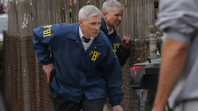 FBI agents search homes for the Boston Marathon bombing suspects in Watertown, Massachusetts April 19, 2013. (Reuters/Brian Snyder)