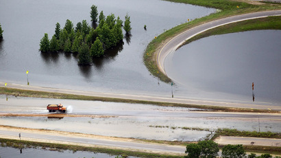 A truck drives along a flooded highway on the Mississippi River on May 23, 2011 in Vicksburg, Mississippi. (Mario Tama/Getty Images/AFP)