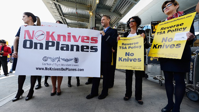 American Airlines and United Airlines flight attendants protest in front of Tom Bradley International terminal in opposition to the FAA's recent decision to start allowing small pocket knives back on board jetliners on April 1, 2013 in Los Angeles, California. (AFP Photo / Kevork Djansezian)