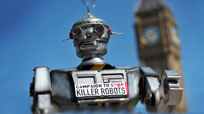 "A mock ""killer robot"" is pictured in central London on April 23, 2013 during the launching of the Campaign to Stop ""Killer Robots"". (AFP Photo / Carl Court)"