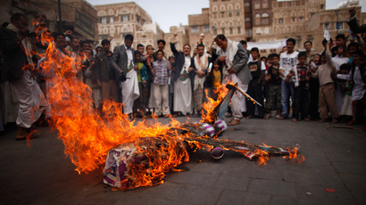 Protesters loyal to the Shi'ite al-Houthi rebel group burn an effigy of a U.S. aircraft during a demonstration to protest against what they say is U.S. interference in Yemen, including drone strikes, after their weekly Friday prayers in the Old Sanaa city April 12, 2013 (Reuters / Khaled Abdullah)