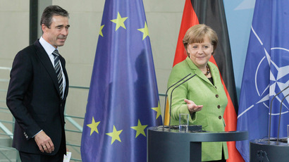 German Chancellor Angela Merkel (R) and NATO Secretary-General Anders Fogh Rasmussen (Reuters / Tobias Schwarz)