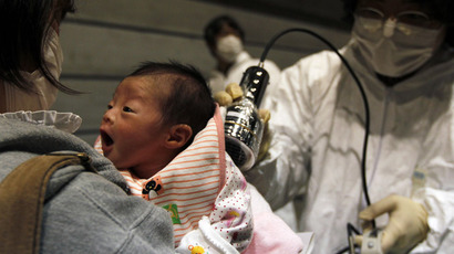 Nagashima Rio who was born on March 15, is tested for possible nuclear radiation at an evacuation centre in Koriyama, Fukushima Prefecture, northern Japan, located about 60 km from the tsunami and earthquake-crippled nuclear reactor, March 31, 2011. (Reuters/Kim Kyung-Hoon)