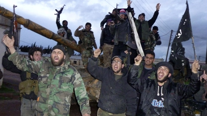Free Syrian Army fighters carry their weapons as they cheer in Qusair town near Homs March 17, 2013. (Reuters)