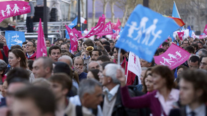 Demonstrators opposed to same-sex marriage protest on April 23, 2013 in Paris after the French national assembly adopted a bill legalising same-sex marriages and adoption for gay couples, defying months of opposition protests.  (AFP Photo)