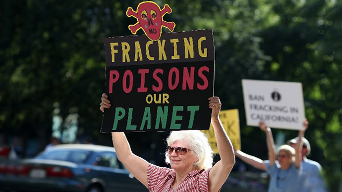 Protestors hold signs against fracking during a demonstration. (AFP Photo / Justin Sullivan)