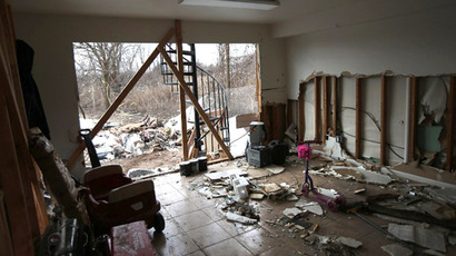 A storm-damaged home awaits repair on January 4, 2013 in the Midland Beach area of the Staten Island borough of New York City. (AFP Photo / John Moore)