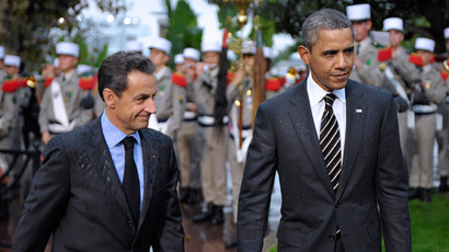 France's President Nicolas Sarkozy (L) and US President Barack Obama arrive for a Franco-American ceremony at the City Hall in Cannes, southern France, on November 4, 2011 (AFP Photo / Philippe Wajazer)