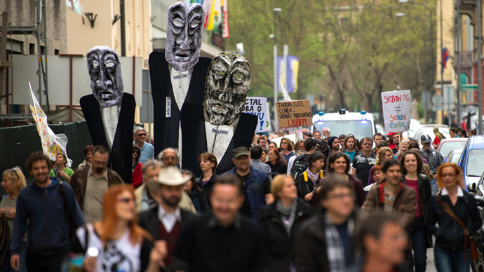 People take part in a demonstration gathering thousands on April 27, 2013 in central Ljubljana to protest against corruption and austerity measures in the crisis-hit eurozone country and to demand early elections take place by the end of the year (AFP Photo / Jure Makovic)