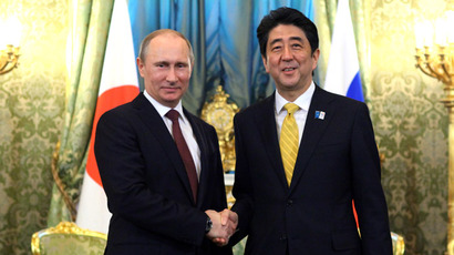 Russian President Vladimir Putin and Prime Minister of Japan Shinzo Abe shake hands prior to their talks in the Kremlin, April 29, 2013. (RIA Novosti/Mikhail Klimentyev)