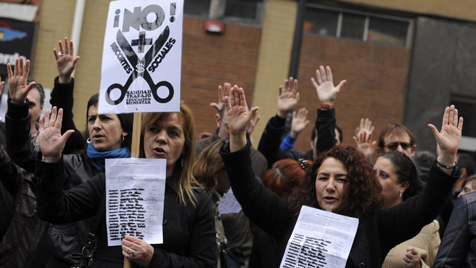 Civil servants chant slogans during a protest against the government's austerity measures outside Asturia's economy regional office in Oviedo, northern Spain April 12, 2013. (Reuters/Eloy Alonso)