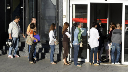 A photo taken on September 04, 2012 shows people waiting in line at a government employment office in the center of Madrid. (AFP Photo)