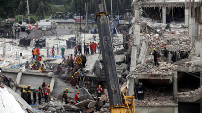 Rescue workers attempt to rescue garment workers from the rubble of the collapsed Rana Plaza building, in Savar, 30 km (19 miles) outside Dhaka April 29, 2013. (Reuters)