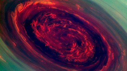The spinning vortex of Saturn's north polar storm resembles a deep red rose of giant proportions surrounded by green foliage in this false-color image from NASA's Cassini spacecraft. (Photo: NASA/JPL-Caltech/SSI). Video courtesy: NASA.