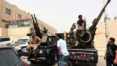 Libyan gunmen keep hold of ministries to ensure ban on Gaddafi-era officials from govt