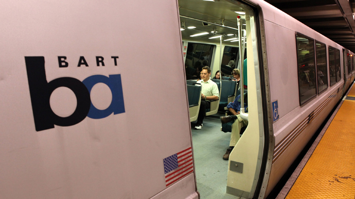 Bay Area Rapid Transit (BART) customers sit on a train at the Embarcadero station in San Francisco, California (AFP Photo / Justin Sullivan)