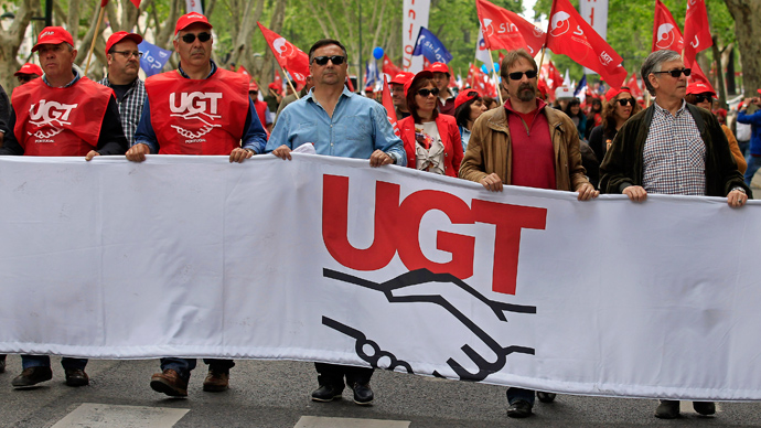 Demonstrators of the UGT (General Workers Union) march along Avenue of Liberdade (Freedom) in Lisbon May 1, 2013 (Reuters / Jose Manuel Ribeiro)