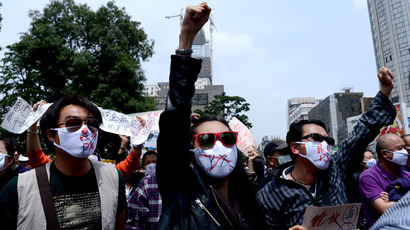 Demonstrators shout slogans in a protest against plans for a factory which will produce paraxylene (PX), a toxic petrochemical used to make fabris, in Kunming, southwest China's Yunnan province on May 4, 2013 (China out / AFP Photo)