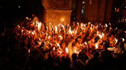 Worshippers hold candles as they take part in the Christian Orthodox Holy Fire ceremony at the Church of the Holy Sepulchre in Jerusalem's Old city May 4, 2013.(Reuters / Baz Ratner)