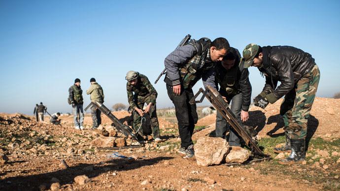 Rebels accuse Assad of large scale massacre after US speaks of arming opposition