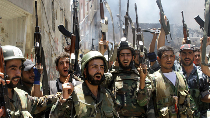 Syrian soldiers celebrate in the al-Midan area in Damascus (AFP Photo)