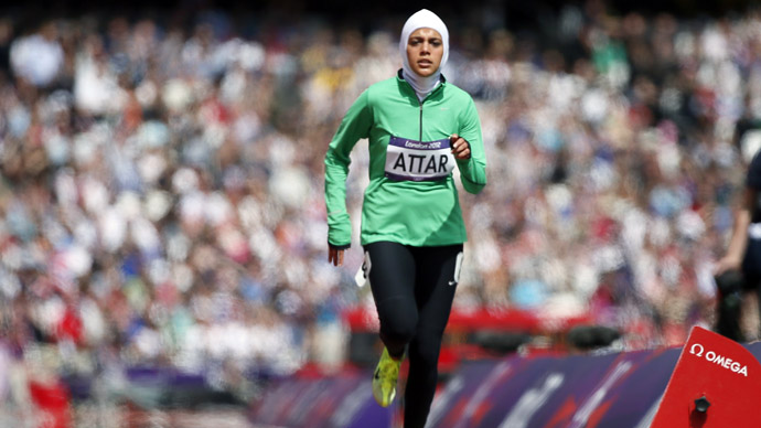 Saudi Arabia's Sarah Attar runs in her women's 800m round 1 heat at the London 2012 Olympic Games at the Olympic Stadium August 8, 2012.  (Reuters/Lucy Nicholson)