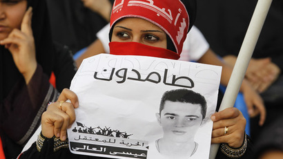 "A protester holds a banner as she participates in an anti-government sit-in organized by Bahrain's main opposition party Al Wefaq in the village of Sitra south of Manama, May 3, 2013. Banner reads, ""Steadyfast. Freedom for the Detainee Isa Al Aali''. (Reuters/Hamad I Mohammed)"