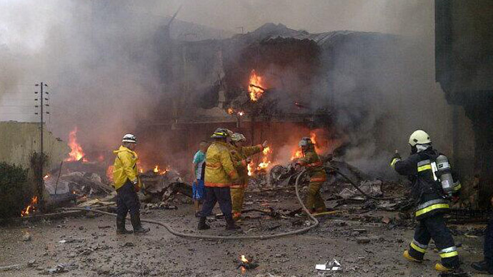 At least 2 dead as plane crashes into residential building in Venezuela (PHOTOS)