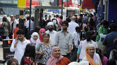 Shoppers walk in a market in the Upton Park neighborhood in east London (Reuters/Paul Hackett)