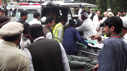 Men help injured blast victims arrive at a hospital following a bomb explosion during an election campaign meeting in Kurram tribal district , part of Pakistan's Taliban-infested tribal belt on the Afghan border on May 6, 2013 (AFP Photo / Ali Afzal)
