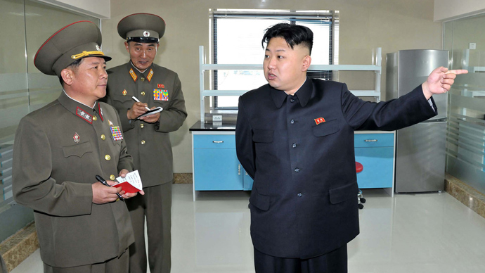 This undated picture released from North Korea's official Korean Central News Agency (KCNA) on May 6, 2013 shows North Korean leader Kim Jong-Un (R) inspecting the newly built Turf Institute of the Bioengineering Branch under the State Academy of Sciences in suburban Pyongyang (AFP Photo / KSNA)