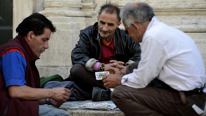 People play cards in a street of downtown Rome. (AFP Photo / Filippo Monteforte)