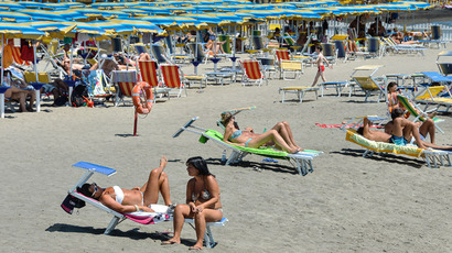Beach-goers lounge on the sands of Lido di Ostia, Rome's nearest beach (AFP Photo)