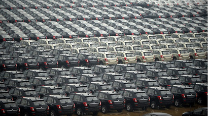 Cars produced by a Chinese private vehicle company are park on a parking lot close to a port on the Yangtze River in Wuhan, central China's Hubei province on May 8, 2013. (AFP Photo)