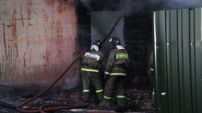 Emergency response team working on the fire scene at a mental hospital in the village of Ramensky. There were reportedly 41 people in the hospital but three survived, 26.04.2013.(RIA Novosti / Ministry of Emergency in Moscow)