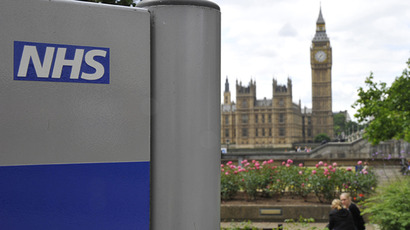 A NHS sign is seen in the grounds of St Thomas' Hospital in London. (Reuters / Toby Melville)