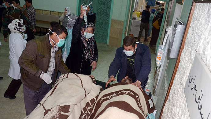In this image made available by the Syrian News Agency (SANA) on March 19, 2013, people are brought into a hospital in the Khan al-Assal region in the northern Aleppo province, as Syria's government accused rebel forces of using chemical weapons for the first time. (AFP/SANA)