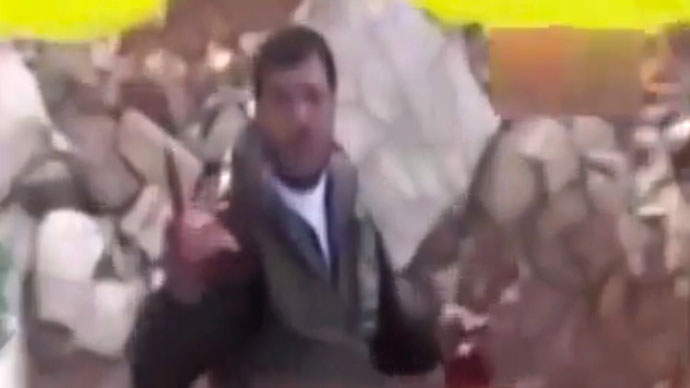 'Rapid descent into sectarian violence': Video shows Syrian rebel biting into soldier's heart