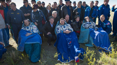 U.S. astronaut Tom Marshburn (R), Russian cosmonaut Roman Romanenko (C) and Canadian astronaut Chris Hadfield sit after leaving the Russian Soyuz space capsule following its landing some 150 km (93 miles) southeast of the town of Zhezkazgan in central Kazakhstan in this handout photo dated May 14, 2013.(Reuters / NASA)