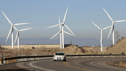A car makes it's way up U.S. Highway 6 as several 2.1 mega watt wind powered turbines owned by Edison Mission Energy, sit a the mouth of Spanish Fork Canyon November 24, 2008 in Spanish Fork, Utah. Each turbine is 300 feet tall, with three 150 foot blades. (George Frey/Getty Images/AFP)