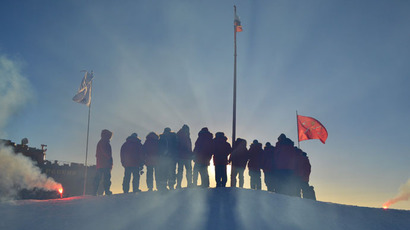 The Russian polar explorers, who traveled to the Arctic to set up a new drifting station SP-40 (RIA Novosti / Anna Yudin)