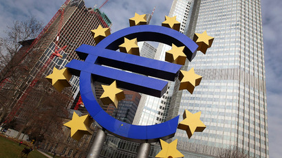 The sculpture displaying a giant Euro sign is seen in front of the European Central Bank (ECB) headquarters  (AFP Photo)