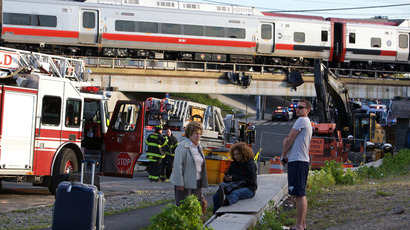 Passengers wait to be picked-up after two commuter trains collided in Bridgeport, Connecticut causing one to derail injuring numerous passengers, May 17, 2013. (Reuters / Michelle McLoughlin)